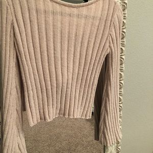 Boutique cropped sweater with open back